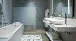 Agence Nuel / Ocre Bleu Idées : salle de bains d'hôtel