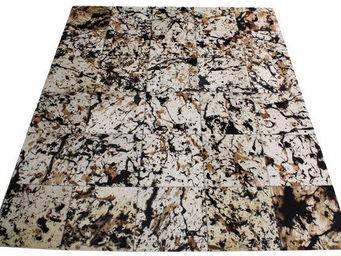 Tergus - tapis peau de vache méché ref.m1 - Tapis Contemporain