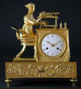 CHARLES AND REBEKAH CLARK - a gilt bronze figural clock - Horloge À Poser