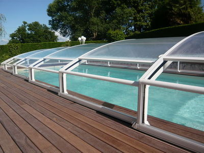 Abrideal - Abri de piscine bas coulissant ou télescopique-Abrideal-MEZZO finition Transparence