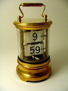 Brookes-Smith - a brass ticket clock - Desk Clock