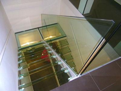 TRESCALINI - Twin staircases-TRESCALINI-Elite : escalier demi tournant acier et verre