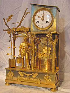 KIRTLAND H. CRUMP - fine brass french mantel clock with unusual butter - Tischuhr